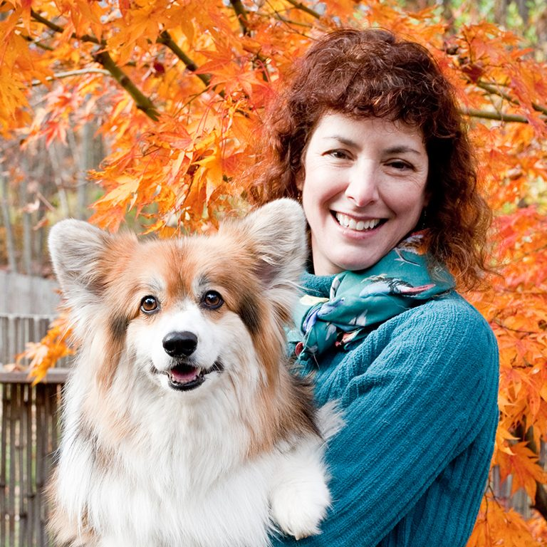 A picture of Dr Lisa Freeman holding a dog
